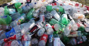 Plastic bottles piled up in landfill.